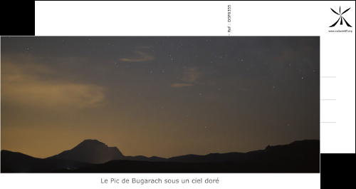 The peak of Bugarach under a golden sky